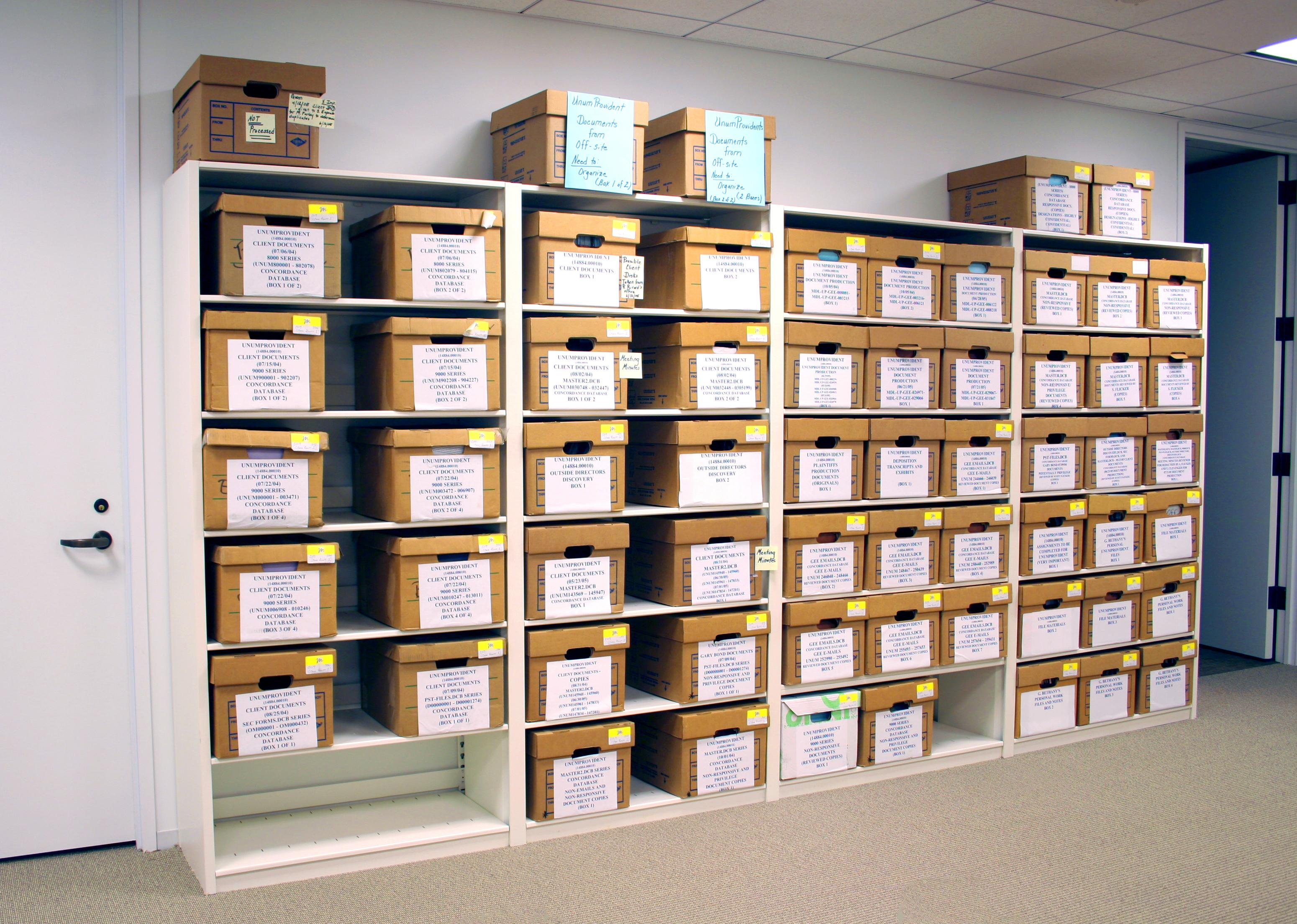 Boxed and archived documents stored on General Storage Shelving at Insurance Agency.