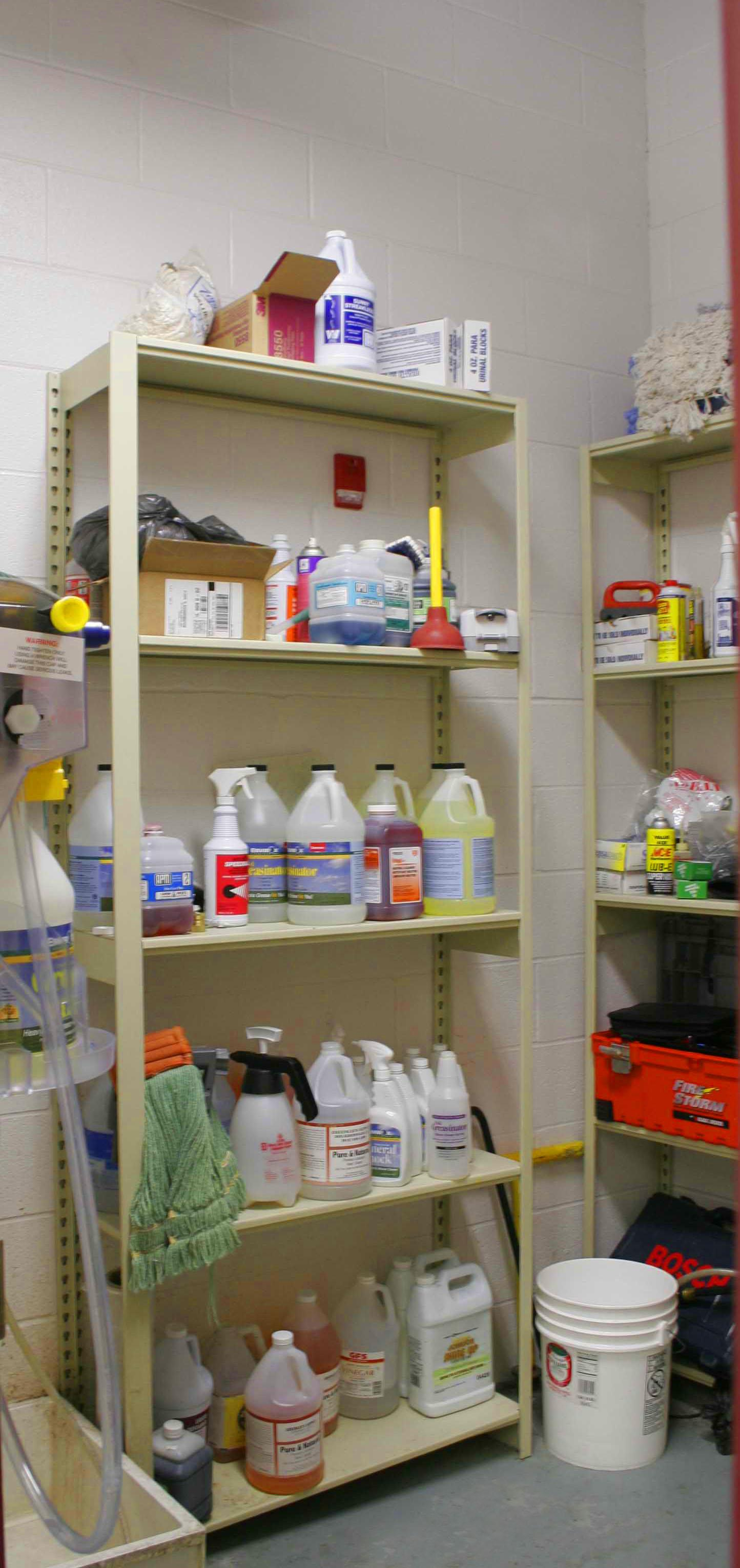 Janitorial supplies on open Aurora Shelving in housekeeping closet.