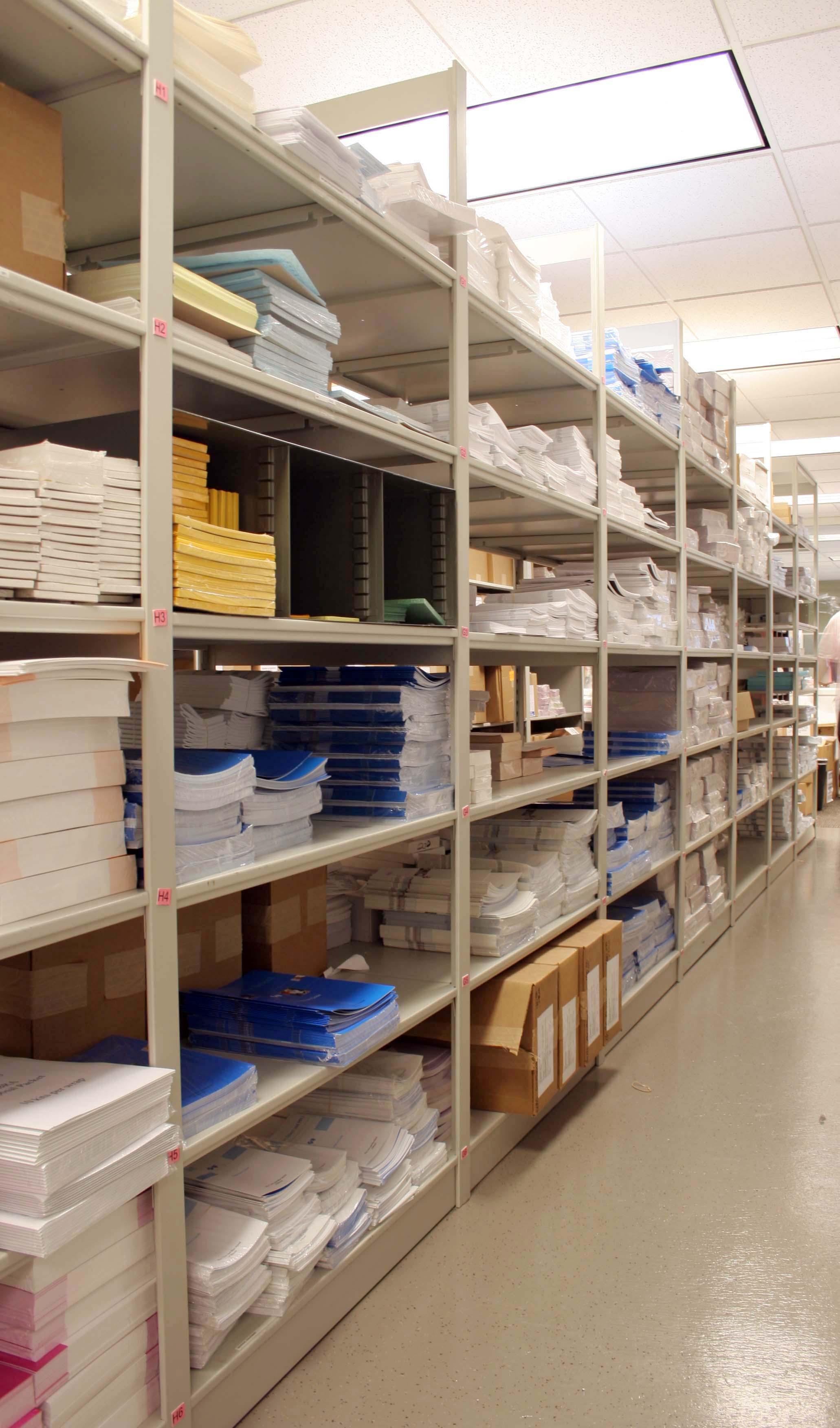 Forms and office supplies are organized on Aurora Storage Shelving at small non-profit.